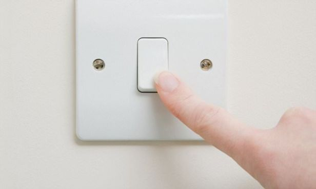 Person using light switch