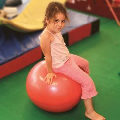 Child sat on exercise-ball
